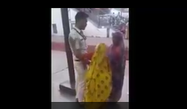 Indian Police man helps old lady to going upstairs - Nice video
