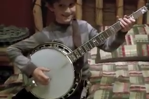 Little guy playing amazing Guitar