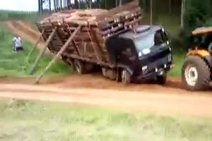 Loaded Lorry pulled with Tractor in Jungle