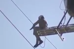 Saving a bird hanging on electricity wire by Helicopter