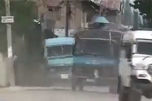 Throwing Stones on Police Vans by People in Kashmir