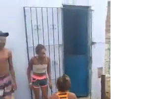 Women street fight in the water